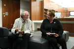 Head of Special Collections Cynthia Becht, right, speaks with Frederick Turner, Professor of Literature and Creative Writing at The University of Texas at Dallas, left