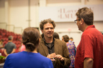 Dave Eggers speaking with LMU faculty Paul Harris
