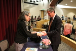Ruth Ozeki signs a copy of the 2016 LMU Common Book for President Timothy Snyder
